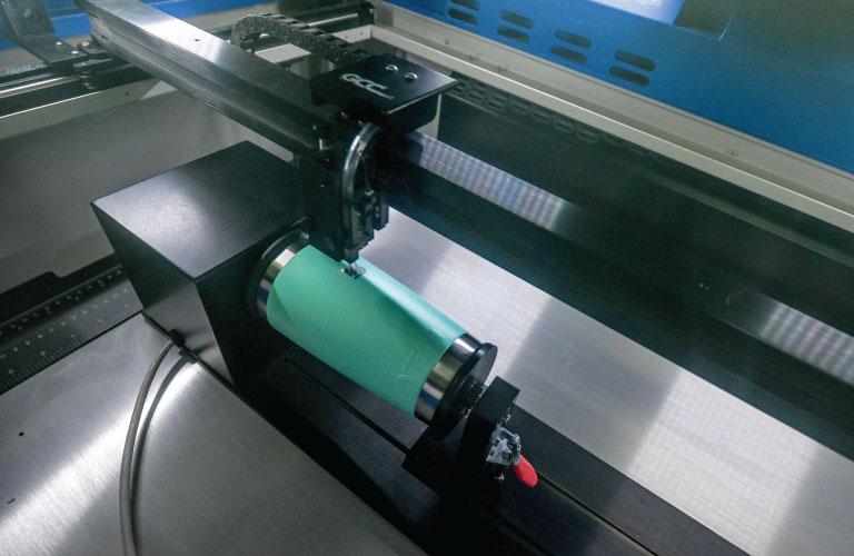 Laser engraving on a yeti mug at prosport